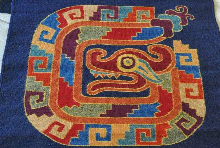 Толтекайотль в символах традиционного ковроткачества